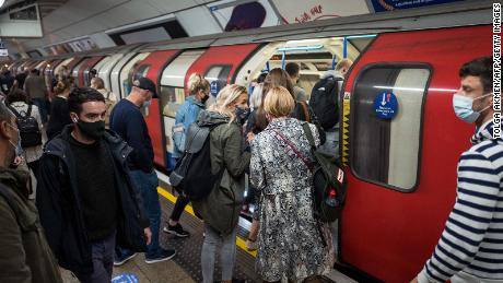 Passengers wearing masks congregate on the London Underground on September 23. You will enter the city & quot High & quot The alert level on Saturday which means no mixing of families at home