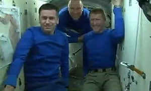 From left: Commander Yuri Malenchenko, NASA's Tim Cobra and Major Tim Beck on the Soyuz capsule.