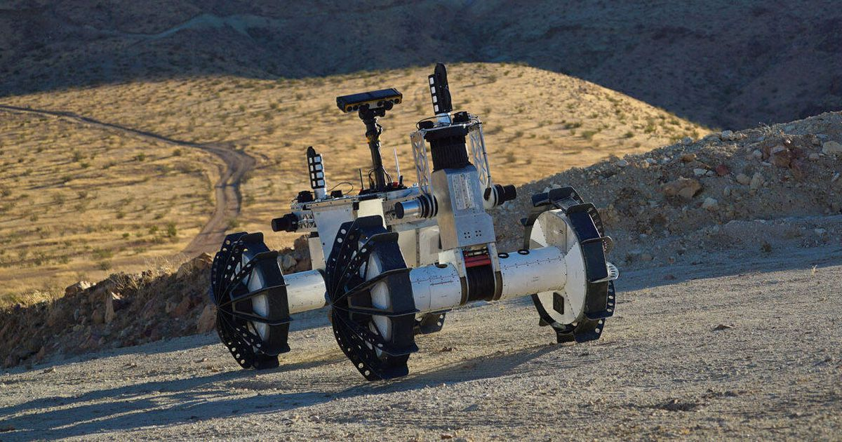 The prototype NASA rover could split into two, and could climb below the deep craters of Mars
