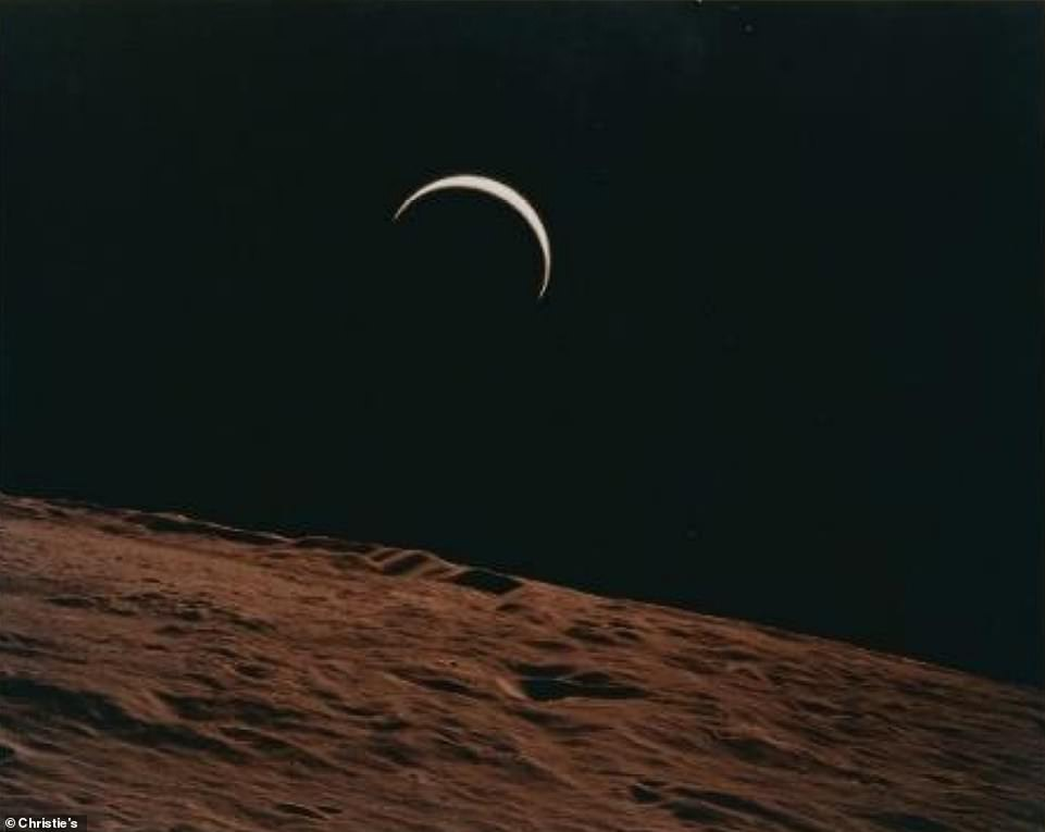 Crescent Earth rising beyond the barren horizon of the Moon, July 26 - August 7, 1971