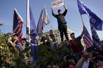 Supporters of President Donald Trump take part in a pro-Trump rally on Saturday in Washington.
