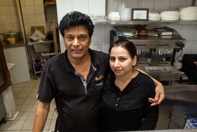 A couple standing in the restaurant's kitchen.