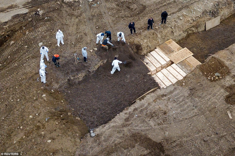 Drone photos taken on April 9 show bodies being buried on Hart Island in New York as the prison administration deals with more burials overall amid the coronavirus pandemic.