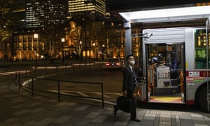 A man wears a face mask to help curb the spread of coronavirus takes a bus near Tokyo Station on Thursday, November 12, 2020.