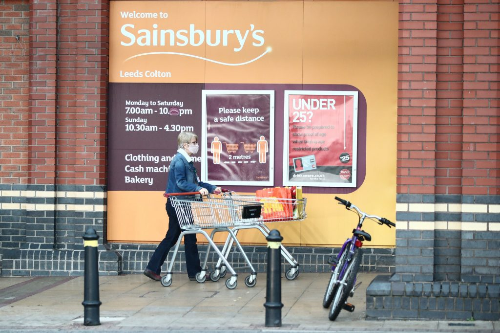 A shopper outside a Sainsbury's supermarket in Leeds on 5 November, 2020.