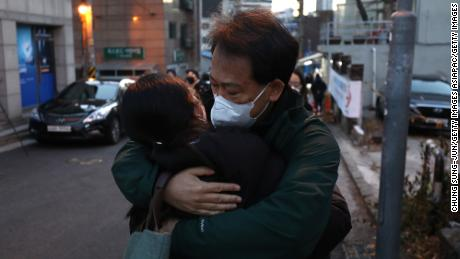 A father embraces his daughter while she passes the college entrance examination amid the Coronavirus pandemic on December 3, 2020 in Seoul, South Korea.