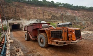 A truck collects copper ore from below the surface at the Chipoloma copper mine in Zambia's Copper Belt region.