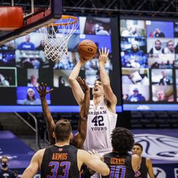 BYU's Richard Harward climbs in a shot against Boise State at the Marriott Center in Provo, Utah on December 9, 2020.