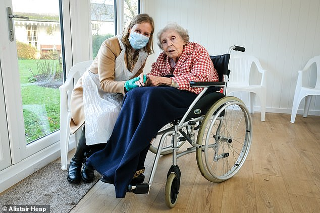 The start of rapid testing in Shotland follows the same move in care homes in England last week, which saw a number of emotional encounters across England.  Pictured: Alexandra Glenister visits her mother, Joe Shepard, at Castle Grove Care Home in Pampton