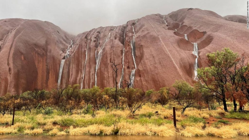 The water flows into Uluru after heavy rains in Northern Territory, Australia