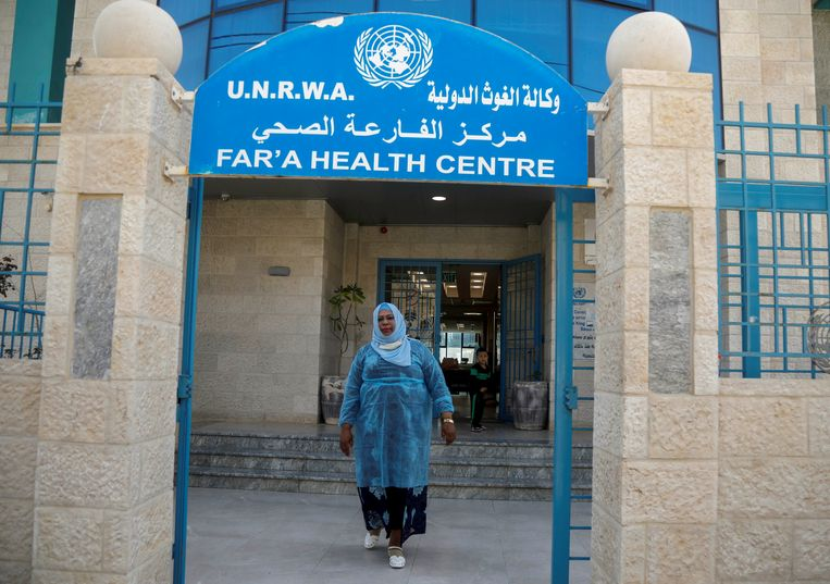 A Palestinian woman leaves an UNRWA health center in the Al Freiha refugee camp in the West Bank.  Reuters photo