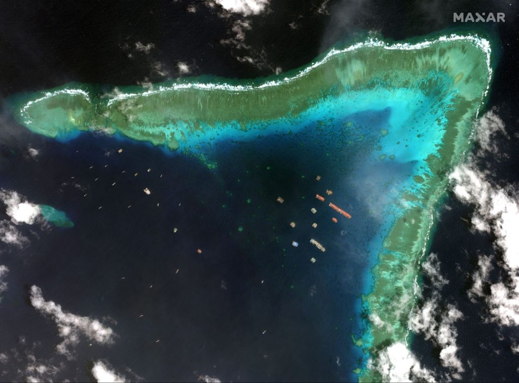 Philippine defense secretary in rhetoric with China over coral reefs