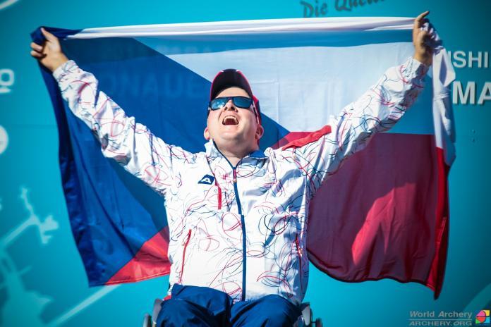 Archer raises the flag
