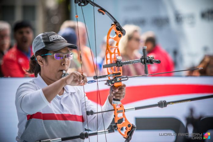 Senator Archer is preparing a bow and arrow