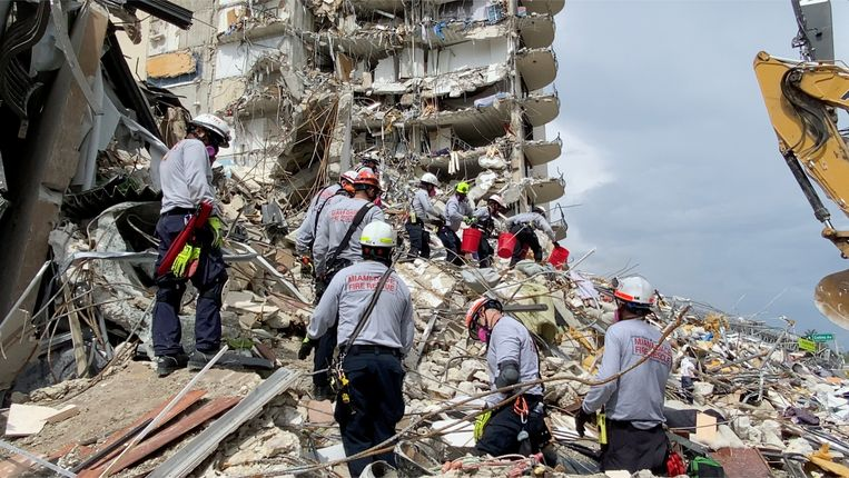 Rescue teams work on unstable hills of cement and steel in the hope of finding survivors.  Image via Reuters