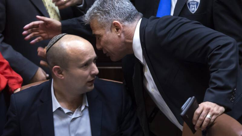 The Israeli parliament approves a new government, and Netanyahu ends the premiership