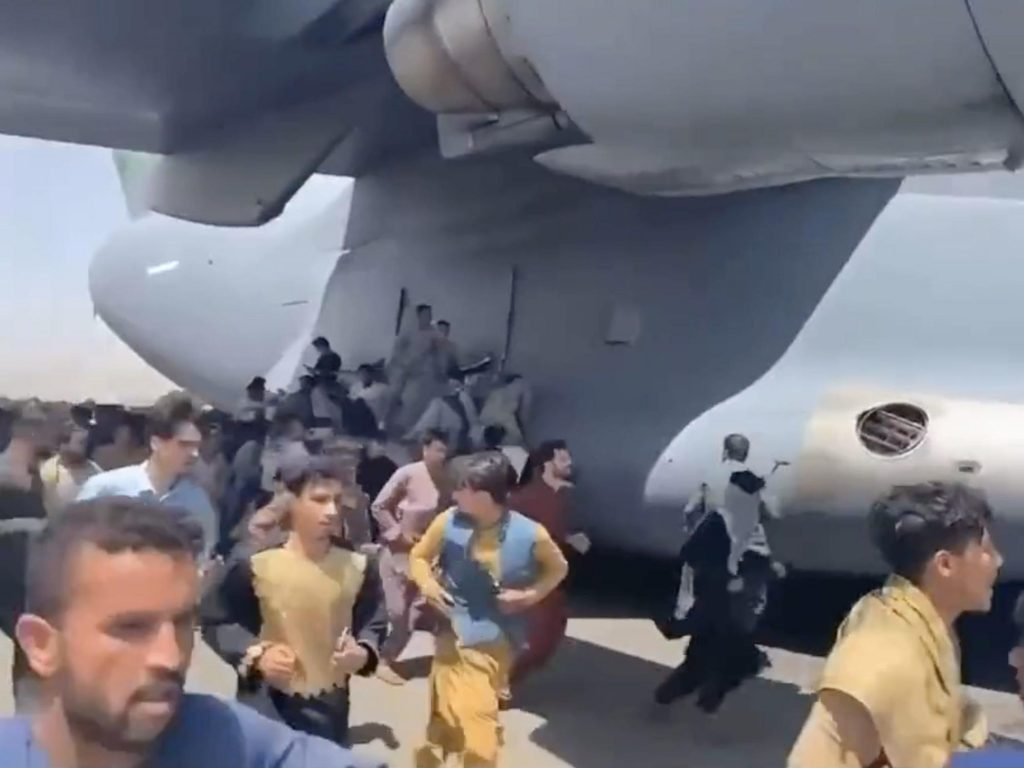 Video shows people clinging to a US Air Force plane at Kabul airport as they desperately try to flee Afghanistan