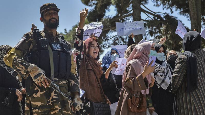 Taliban fire into the air at a mostly women protest in central Kabul